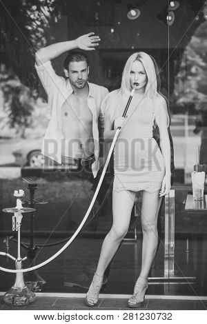 Woman Sensual With Hookah Pipe In Bar. Celebration, Party Concept. Couple Man With Girl At Shisha Ca