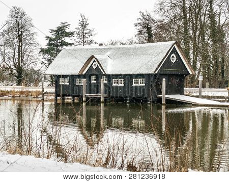 Breukelen, Netherlands - 2010-02-14: Boathouse In The Snow By River Vecht