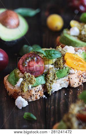 Avocado Toast Sandwich With Avocados, Pesto, Fetaa Cheese, Fresh From The Garden Basil And Heirloom