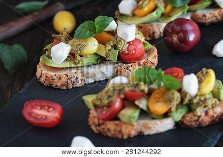 Avocado Toast Sandwich With Avocados, Pesto, Mozzarella Cheese, Fresh From The Garden Basil And Heir