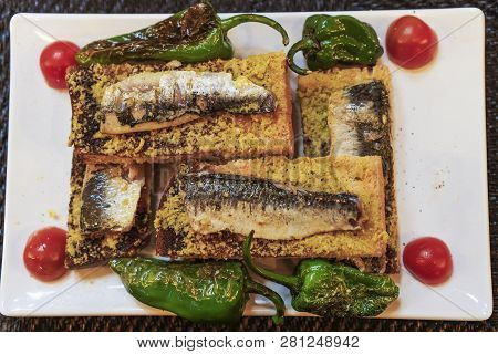 Lisbon, Portugal Traditional Sardines Served Food. Close Up Top View Of Grilled Sardines On Toasted