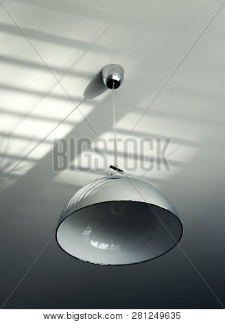 Large Lamp With A Metal Chrome-plated Lampshade As Part Of The Interior. - Image. Original Retro Des