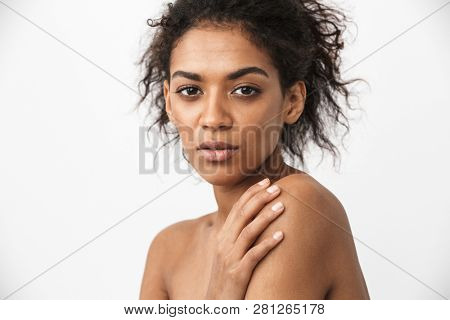 Close up of a beautiful young topless african woman posing over white background poster