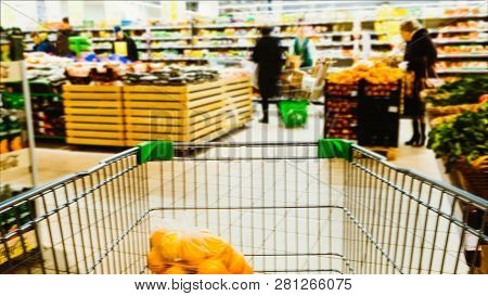 Time-lapse Speed Shopping Trolley Rides To The Supermarket And Filled With Food, Shelving And Blurre