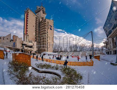 Satu Mare, Romania - December 25, 2018: People Enjoying Winter Christmas Holiday On Ice Rink Outdoor