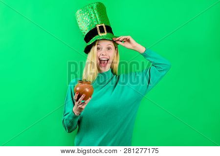 Saint Patrick's Day. Green Top Hat. Girl In Green Top Hat Holds Pot With Gold. Leprechaun. Green Lep
