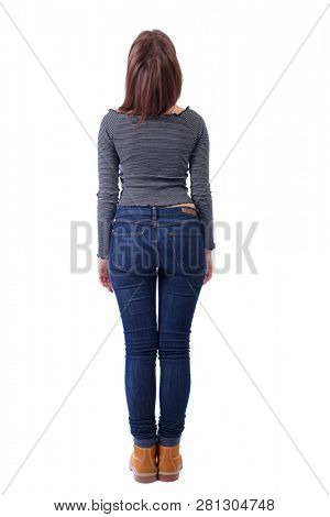 Back view of a woman in jeans.  girl  watching. Rear view people collection.  backside view of person. Isolated over white background. The girl in the striped t-shirt looks up.