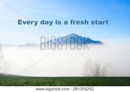 Inspirational, motivational quote against nature background. Every day is a fresh start.