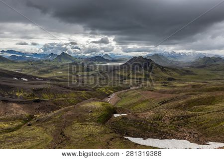 Dramatic Iceland Landscape With Green Mountains Covered With Thick Icelandic Moss And Snow Patches O