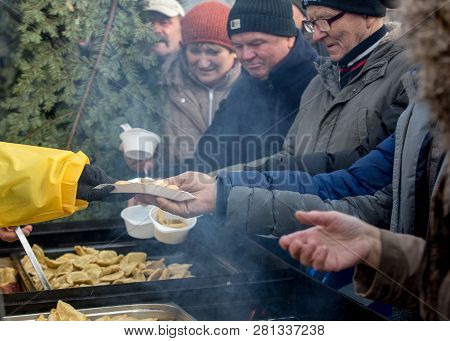 Cracow, Poland - December 16, 2018: Christmas Eve For Poor And Homeless On The Main Square In Cracow
