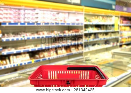 Abstract Blurred Photo Of Store With Basket In Department Store Bokeh Background. Business Concept.