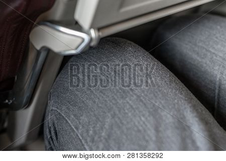 Passenger Leg Bump Into Back Seat In Low-cost Commercial Airlines. Narrow Space For Person Knee In B