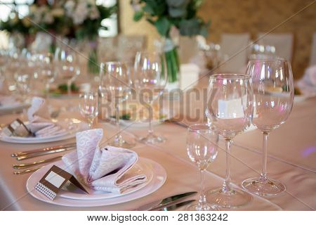 Wedding Table Decorated With Flowers. Table Setting For A Banquet Before The Meal. Beautiful Table S