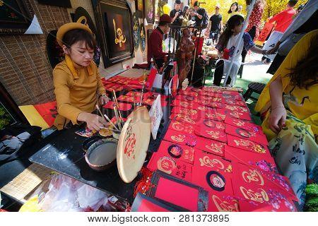Ho Chi Minh City, Vietnam 01-2019: Vietnamese Scholar Write Calligraphy At Lunar New Year. The Calli