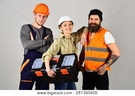 Professional And Confident. Constructing Engineers Or Architects. Professional Working Team. Constru