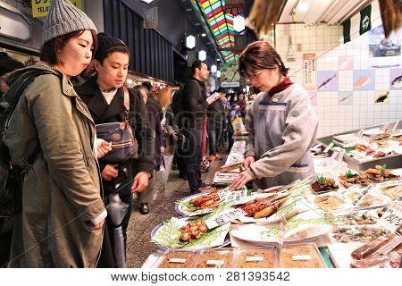 Kyoto, Japan - November 27, 2016: People Shop At Nishiki Market In Kyoto, Japan. Nishiki Is A Popula