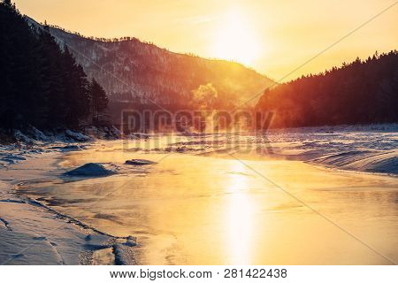 Winter Snow Frozen River In Mountains. Snow Winter Mountain River Valley Landscape. Winter Snow Froz