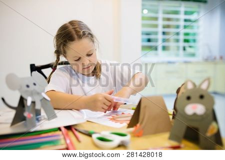 Crafts For Kids. Child Making Colorful Paper Animals At Art Class. Creative Little Girl With Glue St
