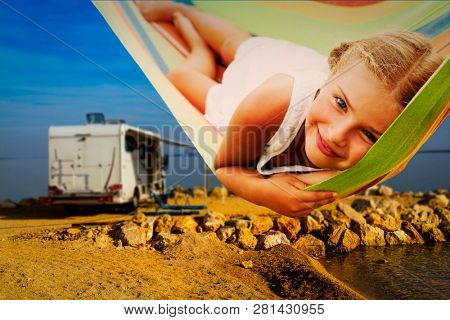 Camping RV travel with camper, summer beach. Happy smiling beauty girl in hammock on mototorhome vacation.