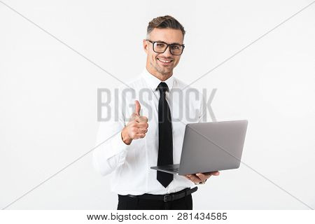 Image of a handsome business man isolated over white wall background using laptop computer showing thumbs up gesture.