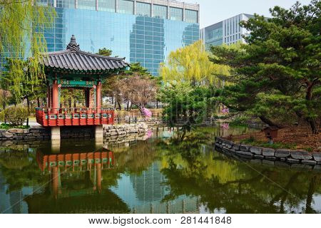 Yeouido Park public park pond with pavilion summerhouse in Seoul, Korea