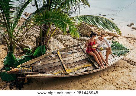 Honeymoon Trip. Wedding Travel. Couple In Love On An Island Off The Coast. Couple On The Island. Man