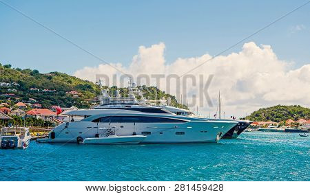 Gustavia, St.barts - January 25, 2016: Yachts Anchored At Sea Pier On Tropical Beach. Yachting, Luxu