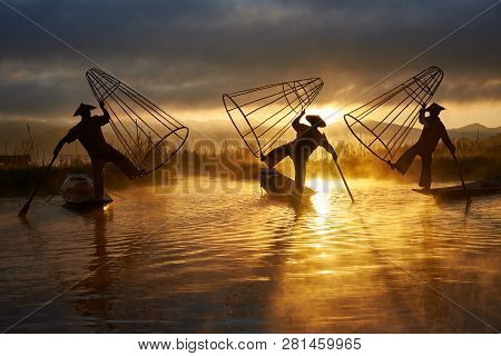 Inle, Myanmar - November 28: Three Fishermen Perform The Old Traditional Fishing Method On The 28th