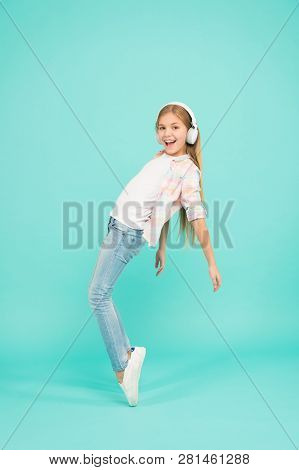 Happy Songs Putting Her In A Good Mood. Dancing Girl. Happy Small Girl Dancing To Music. Small Girl