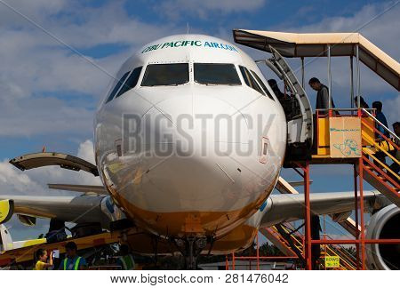 Cebu, The Philippines - 14 Nov 2018: Aircraft Front View With Passengers On Stairs. Landed Aircraft