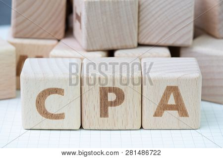 Cpa, Certified Public Accountant Or Cost Per Action Concept, Cube Wooden Block Building Word Cpa, Ce