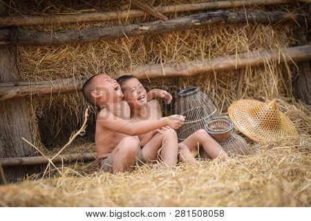 Asia Child Laugh / The Boy Friend Happy Funny Laughing And Smile At Agricultural Farm In The Country
