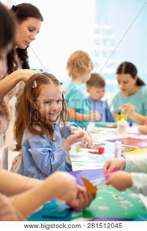 Development Learning Children In Preschool. Childrens Project In Kindergarten. Group Of Kids With Te