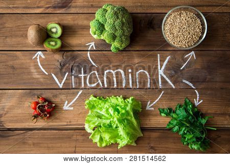 Foods Highest In Vitamin K On A Wooden Board. Healthy Eating. Top View