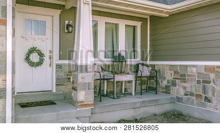 Beautiful Home Exterior With Porch Yard And Stairs