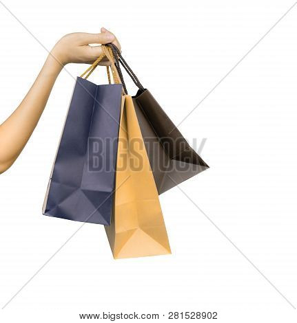 Woman Carrying Paper Shopping Bags Isolated On White Background. Adult Woman Hand Hold Three Shoppin