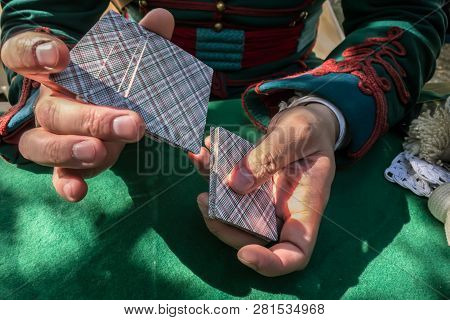 Man's Hands Shuffle A Deck Of Cards