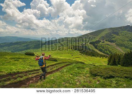 Traveler Hike Alone On Mountain's Peak.