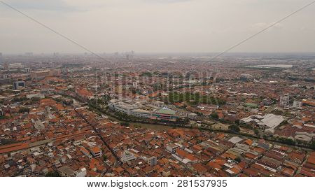 Aerial Cityscape Modern City Surabaya With Skyscrapers, Buildings And Houses. Urban Environment In A