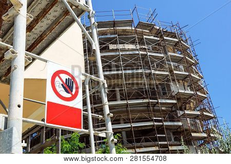 No Entry Sign On The Fence In Contruction Site With House Under Construction