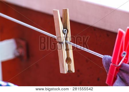 Set Of Three Wooden Cloth Pegs On Rope