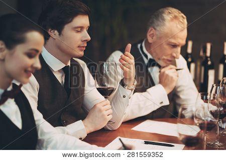 Confident Sommelier Tasting Wine In Restaurant. Checking Taste, Color, Sediments Of Wine. Confident