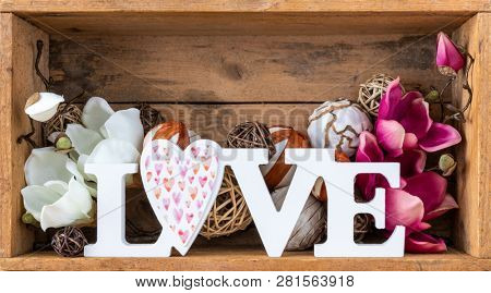 An image of a love decoration in a wooden box