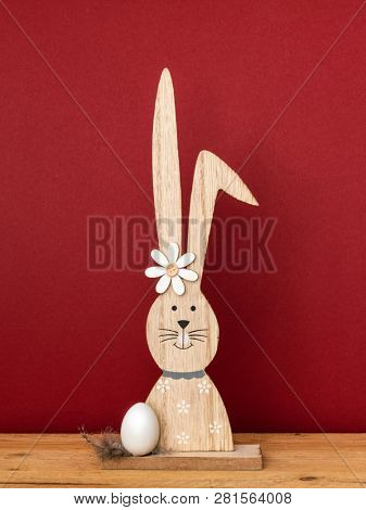A sweet easter bunny figure with an egg
