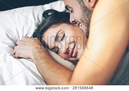 Happy Romantic Couple Having A Tender Moment In The Bed - Young Passionate Lover Waking Up In The Mo