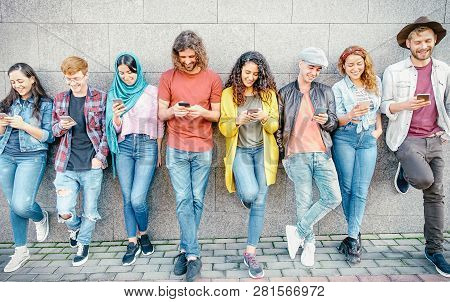 Group Of Fashion Friends Watching On Their Smart Mobile Phones - Millennial Generation Z Addicted To
