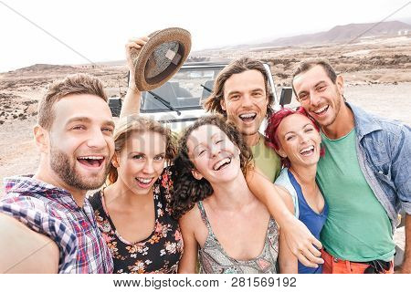 Group Of Travel Friends Taking Selfie In The Desert During A Roadtrip  - Happy Young People Having F