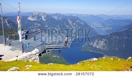 KRIPPENSTEIN AUSTRIA - JULY 9: unidentified people on a Five Fingers most spectacular viewing platform in the Alps. Built over a precipice of about 400 m (1200 ft) depth. July 9, 2011, Austria.