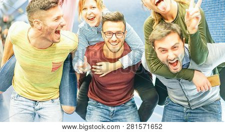 Group Of Friends Having Fun In A Underground Station - Men Piggybacking Their Girlfriends - Young Pe
