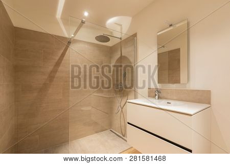 Modern marble bathroom with spotlights to illuminate the scene. nobody inside
